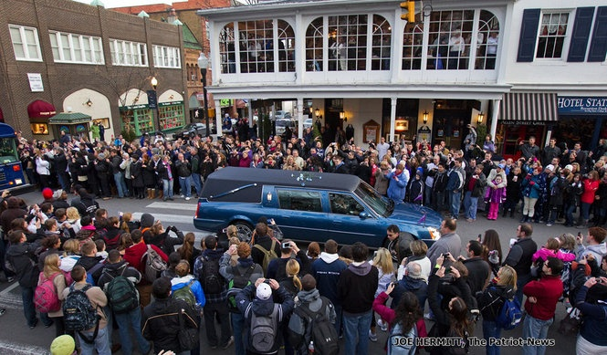 Thousands of mourners line College Avenue to pay their respects to legendary Penn State coach Joe Paterno as the funeral procession drives by the campus of Penn State University. JOE HERMITT, The Patriot-News