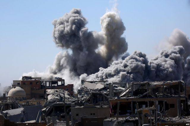 Smoke billows in the embattled northern Syrian city of Raqa