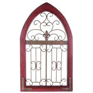 "Give your home some architectural appeal with Rustic Red Metal & Wood Wall Decor. This wall piece features a gothic window design with a metal interior and a fleur-de-lis. Perfect for giving walls depth, texture, and color, this wall decor is perfect for hanging in living rooms, hallways, offices, and more!    	Dimensions:    	  		Length: 40""  	  		Width: 24""      	Hanging Hardware: 2 metal loop hooks 20 1/2"" apart"