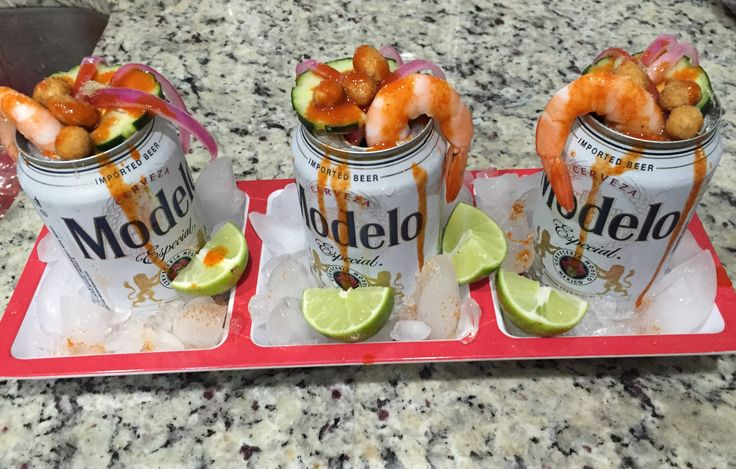 Preparadas - Modelo beer, marinate shrimp and sliced purple onions, in lots of lime, overnight, marinate cucumbers in lime an hour before prep, top beer with onions, shrimp, cucumber, and Japanese spicy peanuts, lime salt, and Tapatio hot sauce.