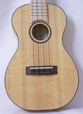 Bytown ukuleles are handbuilt here in Ottawa by Joel Jacques and Mark Rogers. The Li'l Abner Concert Ukulele features a solid spruce top, back & sides, maple fretboard, bridge & headstock, planetary tuners, a compensated bone saddle and comes with a gig bag.