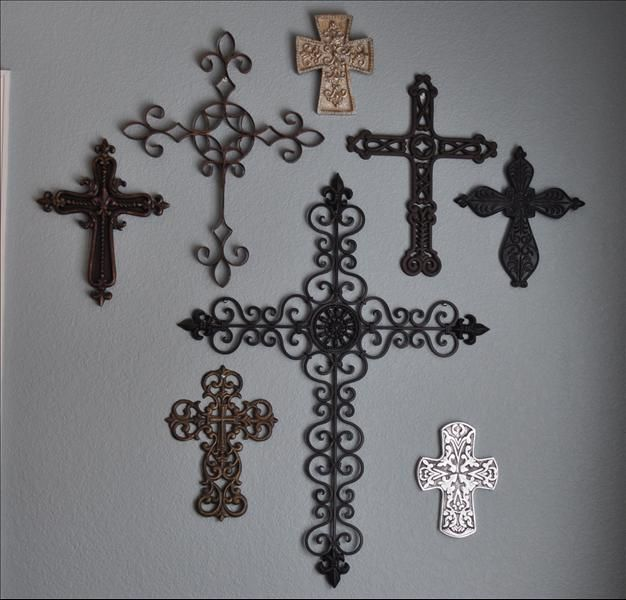 "i love my ""wall of crosses"".. my mom and my sister both have a wall of crosses in their house as well-- just something we love to collect (:"