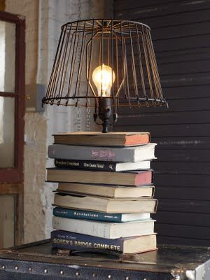 DIY book lamp. I'm in looove with the dim lightbulb and wire shade