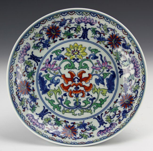 Chinese Doucai Porcelain Plate. China, Early 20th C., Doucai porcelain plate, decorated with a dense and colorful pattern of lotus flowers and auspicious symbols. Height 7 3/4 in.