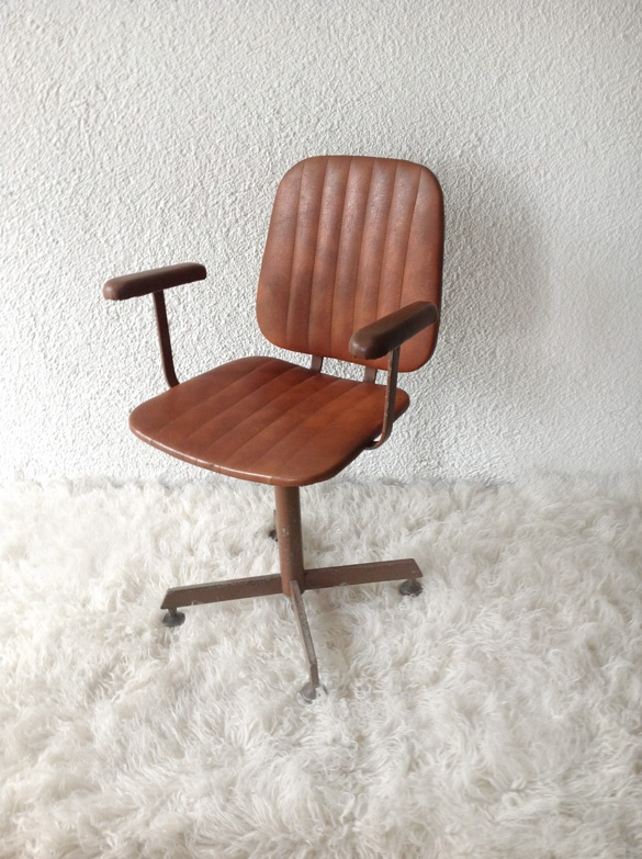 upholstered armchair with original brown Skay