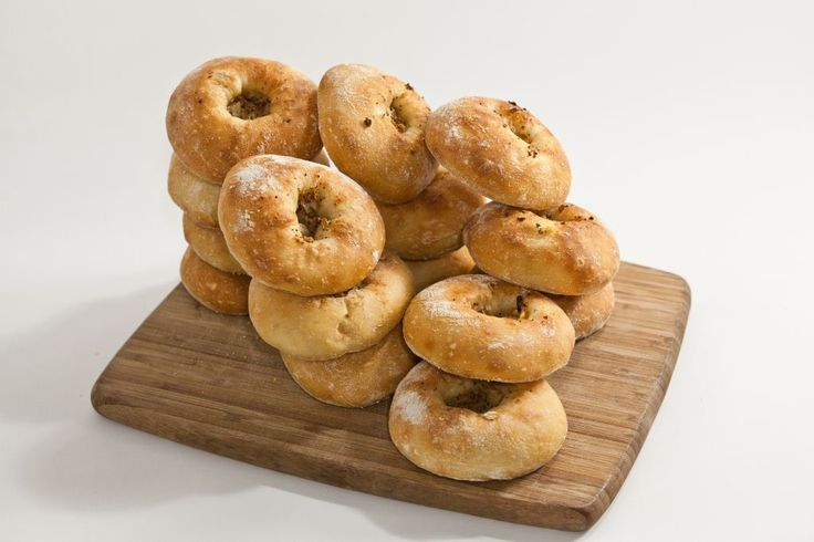 The bialy is not a sub-type of bagel, it's a thing all to itself. Round with a depressed middle filledwith cooked onions and sometimes poppy seeds, it is simply baked (bagels are boiled)
