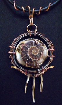 By Richard Salley - Pendant with jar lid, copper wire, Faux Bone, ammonite fossil.