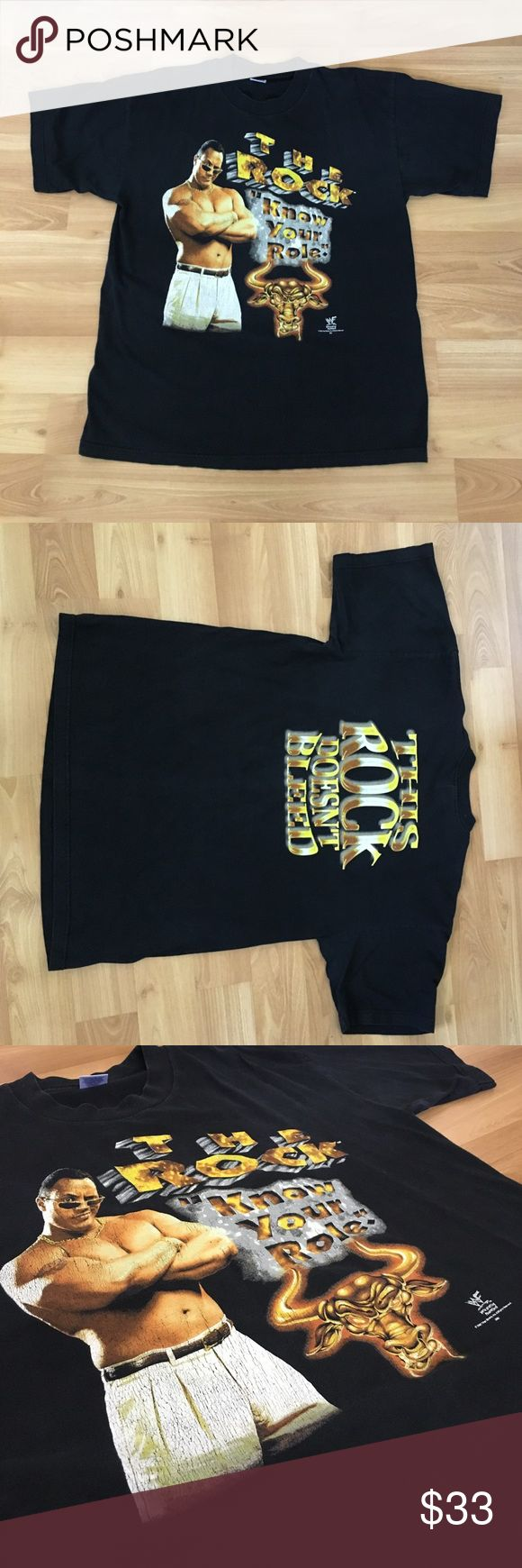 Vintage 1998 The Rock WWF T Shirt Sz XL Vintage the rock t shirt wwe wwf t shirt size extra large. This shirt features Dwayne the rock Johnson with the quote the rock know your role on the front. On the back, this rock doesn't bleed. The rock is one of the best wrestlers of all time and has numerous phrases including can you smell what the rock is cooking. Shirt only shows a few signs of cracking on the logo, but is in great condition for 20 years old. WWE Shirts Tees - Short Sleeve