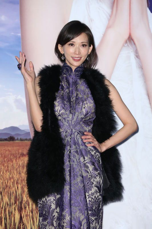 Chiling Lin in blue cheongsam to attend media conference.