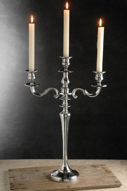 29.99 SALE PRICE! With its classic design, the Silver Candelabra will bring grandiose elegance to your colonial home. This piece is plated in chrome-tinted aluminum a...