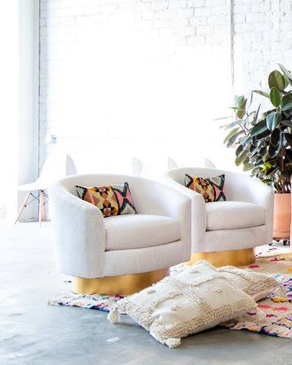 Before & After: A Labor of Light from Wayfair. With these white and gold midcentury accent chairs, bright southwestern style pillows, and a Morrocan boucherouite rug, this living room is a modern bohemian dream!