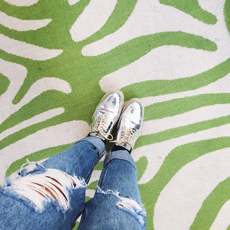 ripped jeans, metallic shoes