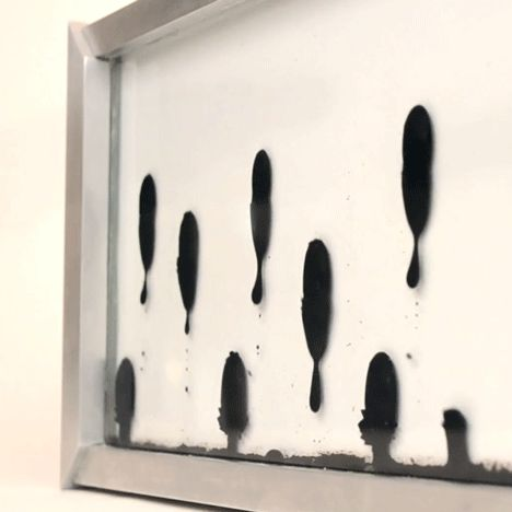 This clock by Dutch designer Zelf Koelman spells out the time with magnetised fluid under the control of electromagnets