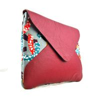 Handmade by Fundi hand stitches African Print and and leather to create unique womens bags. The Adisa is a stylish envelope flap clutch bag that can double as a bag for your ipad. http://www.moderntradition.com.au/large-clutches/