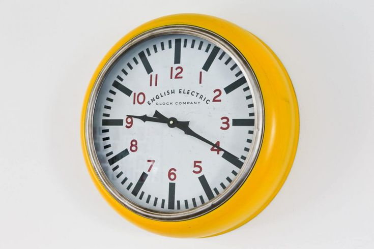 Yellow retro wall clock by English Electric Clock Company