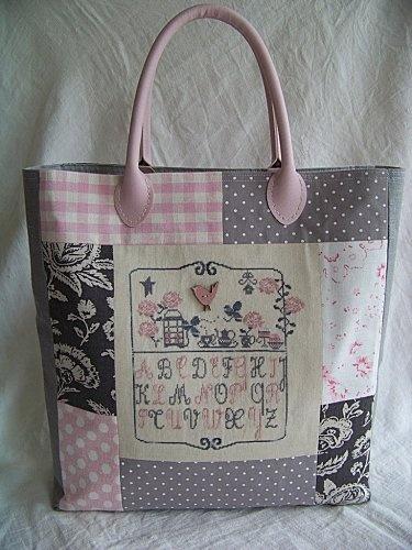 Joli sac. ++ assortiment de tissus roses et gris.