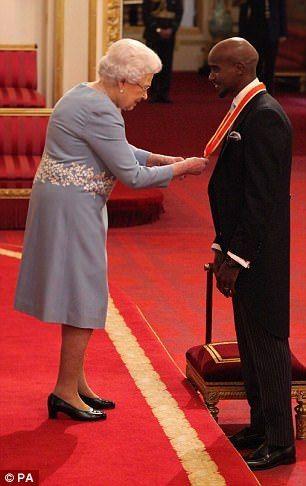 Queen Elizabeth II awards athlete Mo Farah his knighthood at Buckingham Palace. Nov. 14, 2017