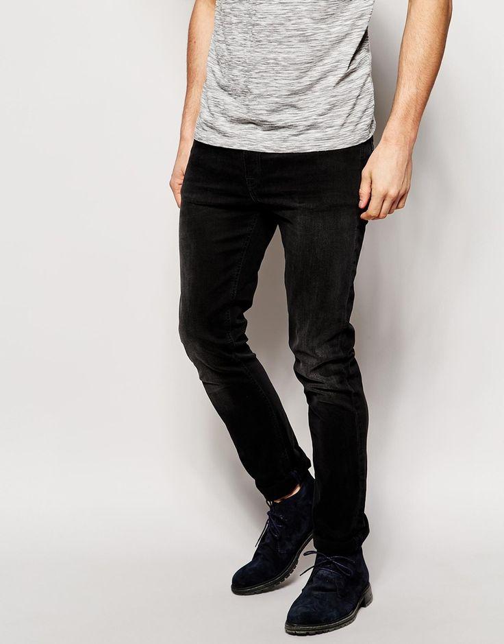 Jeans von Nudie 10,5oz schwerer Powerstretch-Jeansstoff dunkle Waschung tiefer Sitz verdeckter Reißverschluss enges Bein enge Passform Maschinenwäsche 98% Baumwolle, 2% Elastan unser Model trägt Größe 81 cm/32 Zoll und ist 185,5 cm/6 Fuß 1 Zoll groß