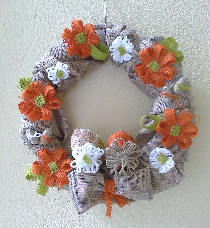 Easter handmade wreath with colored burlap, twine and hand knitting yarn