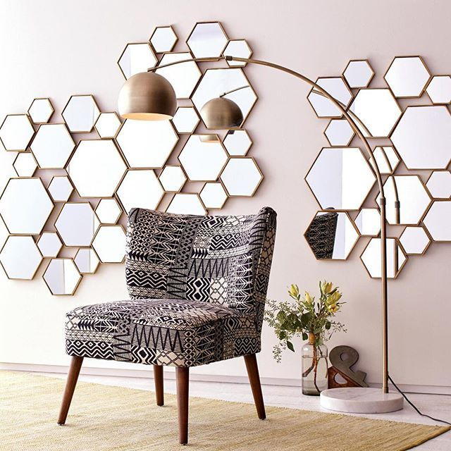 Make a grand statement with our new Brass Metal Hexagon Mirror Panels, featuring a cluster of brass hexagon-shaped mirrors in an array of sizes and depths for added dimension. (link in profile to #shop) #WorldMarket #WallArt #HomeDecor