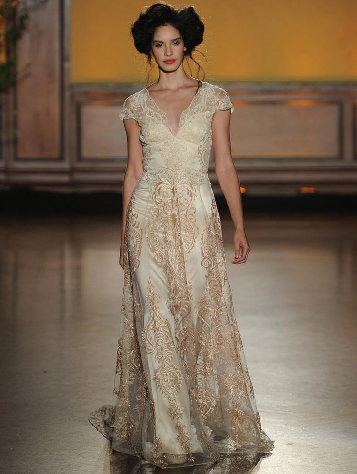 Claire Pettibone Fall 2016 La Belle short sleeve dress with pearl-beaded bodice and rose gold embroidery | https://www.theknot.com/content/claire-pettibone-wedding-dresses-bridal-fashion-week-fall-2016