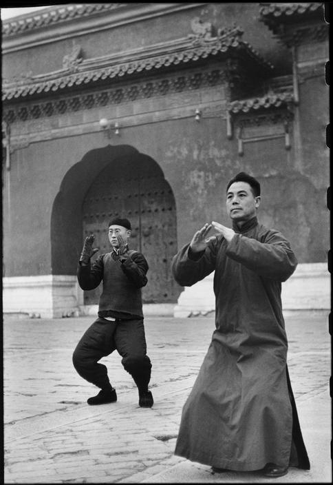 Henri Cartier-Bresson CHINA. Beijing. December 1948 Tai Chi Chuan in the Tai-miao Gardens
