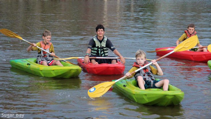 Campers kayaking with Sugar Bay Counselor, Fives.