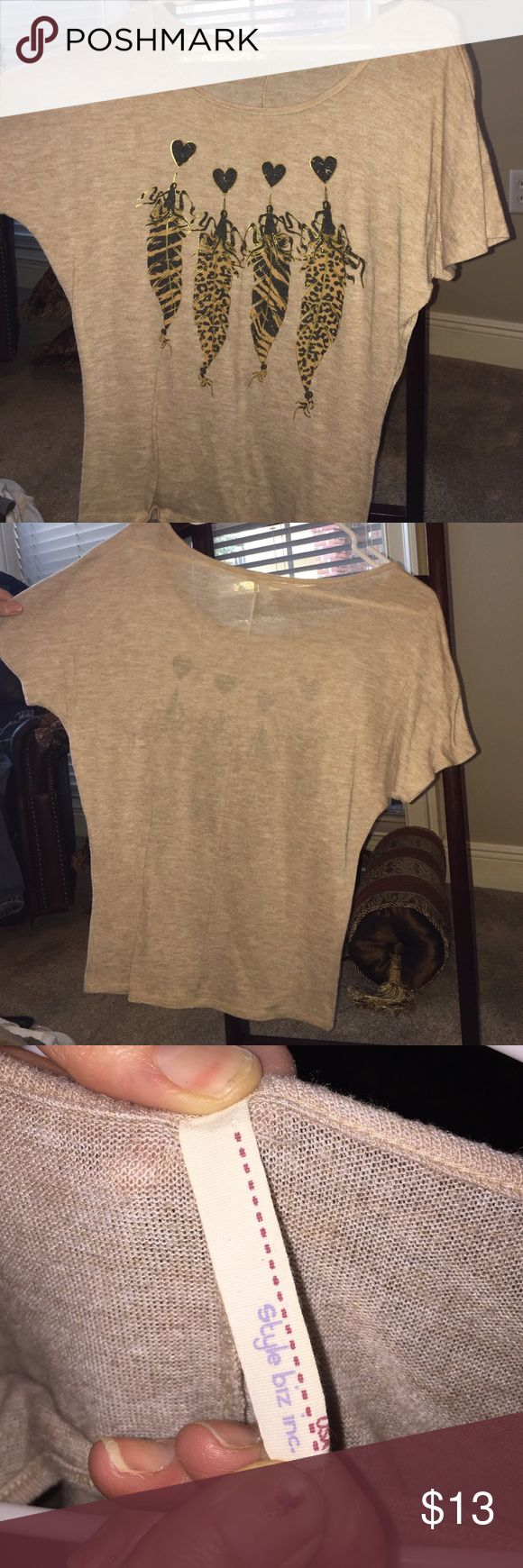 Soft beige tee wide neck with hearts and feathers Lightly worn beige tee size small tee with soft material cute hearts and feathers. Wide neck INC Tops Tees - Short Sleeve