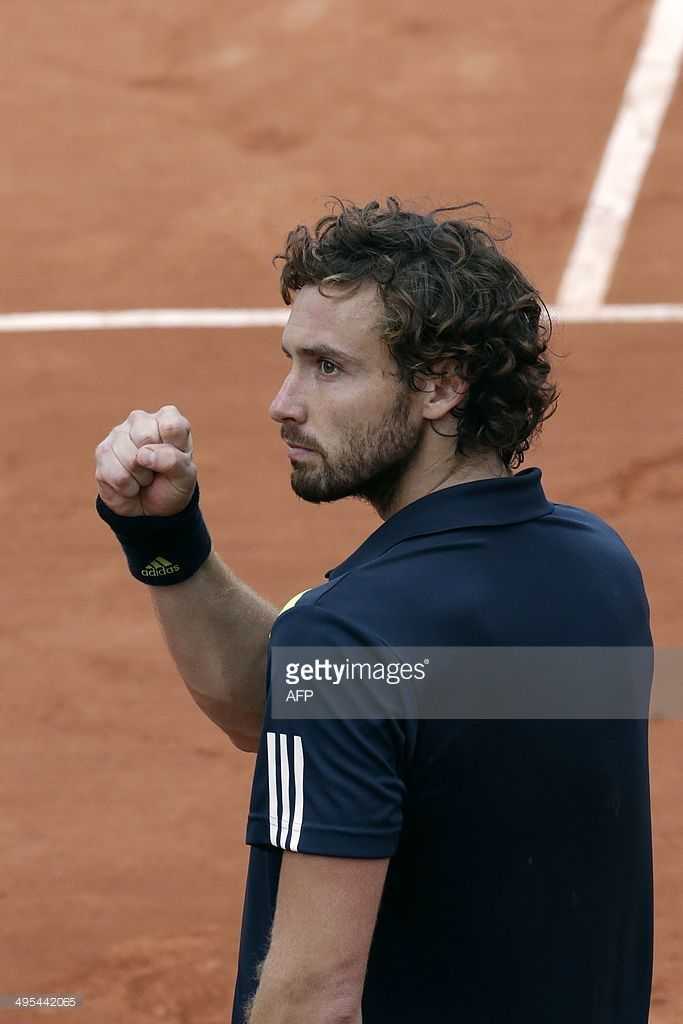 Latvia's Ernests Gulbis celebrates after winning his French tennis Open quarter…