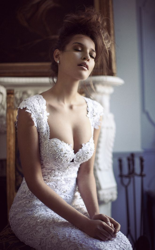 Pearl beaded, lace, wedding gown, just beautiful but maybe not so much cleavage