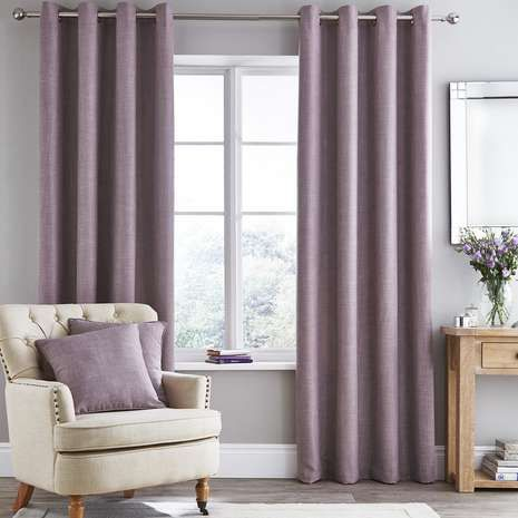 Fully lined to prevent disturbances from sunlight, these eyelet curtains are finished in mauve and are available in a variety of sizes....