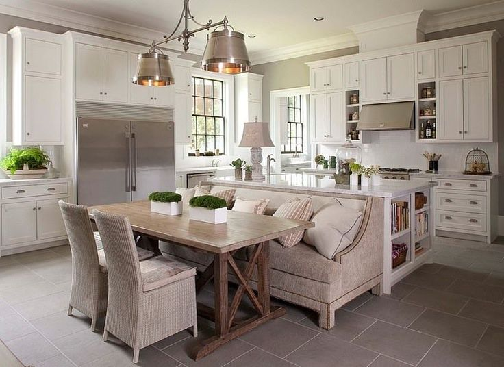 Sofa as banquette seating up against kitchen island.