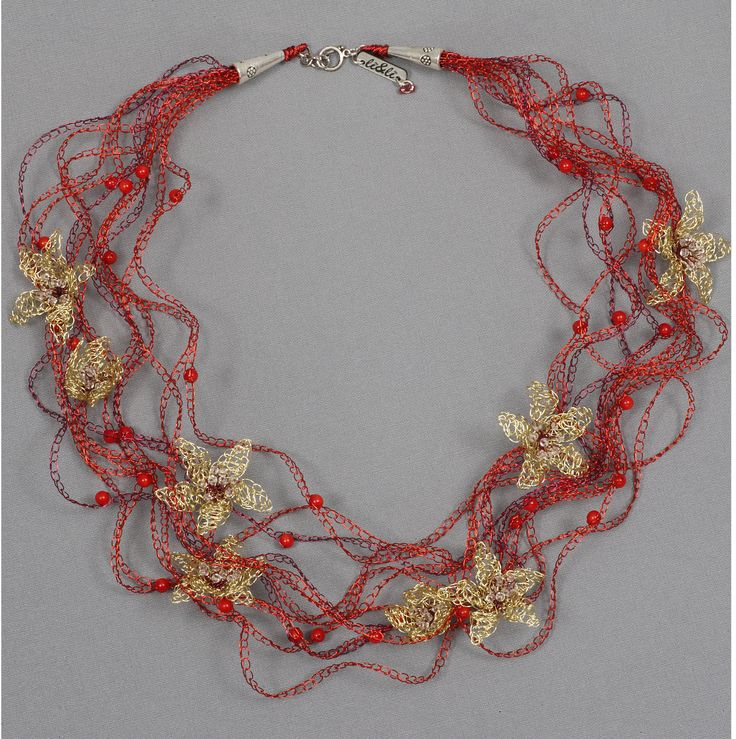 made of enameled coper and coral stones
