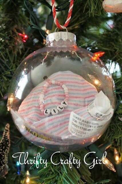 Put baby's hospital cap and bracelet in a clear ornament. Such a cute idea!!