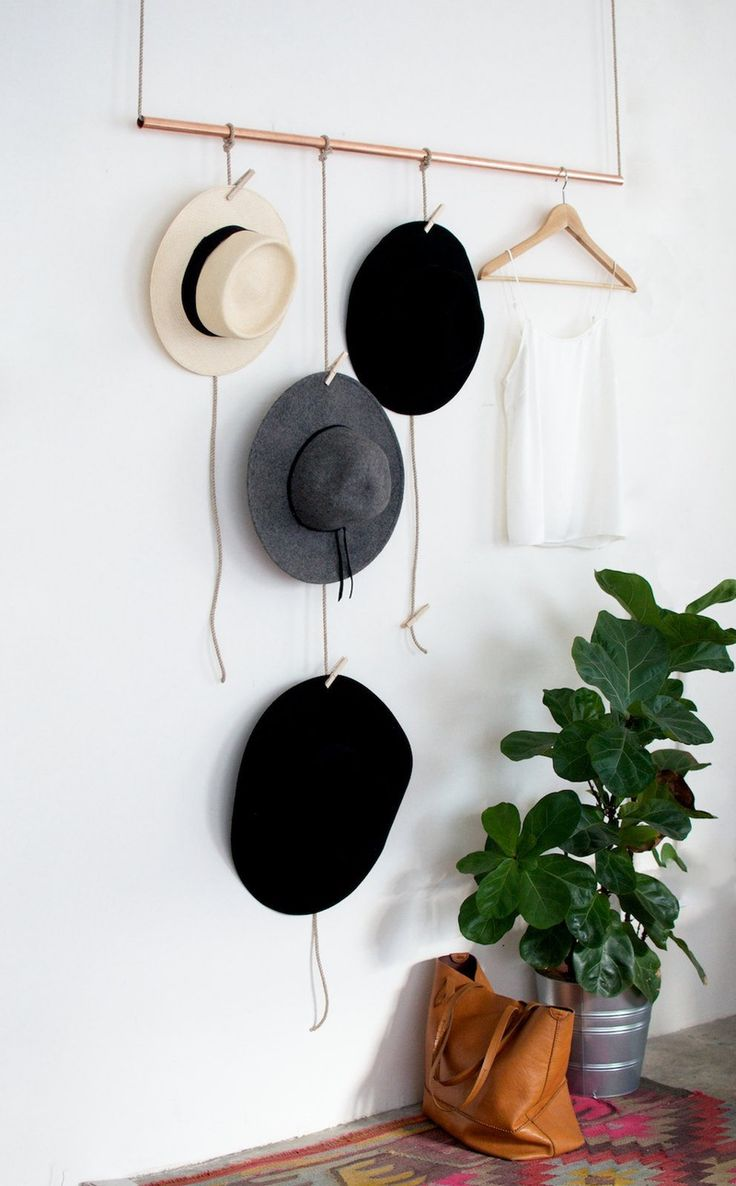 Glam up your space with a minimalist DIY hanging copper hat rack.