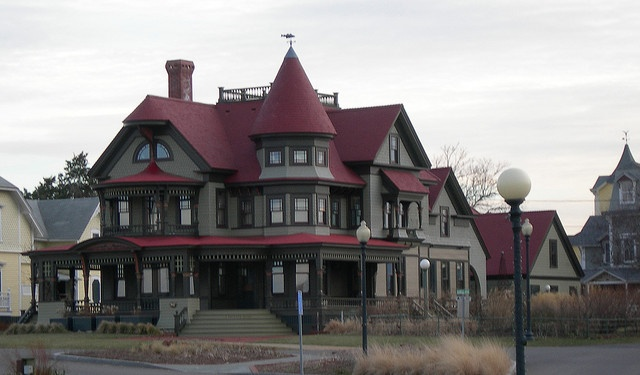 Located in Oak Bluffs (East coast), featured on an episode of This Old House, via Flickr. Wrap around porch and a widow's walk on the roof.