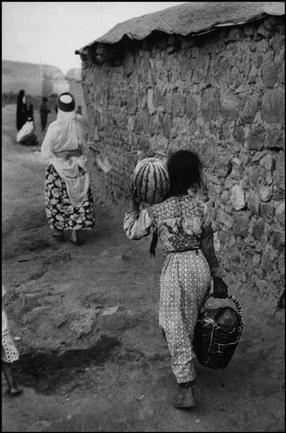 Ara Güler. Returning from the market with watermelons, near the Mardin Gate, Diyarbakir.