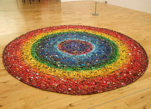 This vibrant rainbow circle was created by artist David Waller, who rounded up 6,000 toy cars he's collected since childhood and arranged them into rings of color, reminiscent of an OCD sufferer's childhood memory.