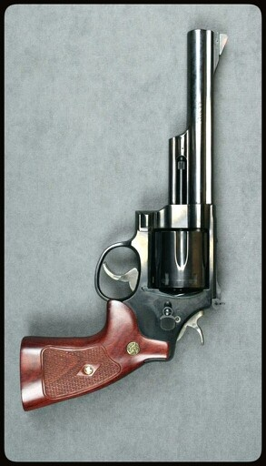 "The Smith & Wesson Model 29 is a six-shot, double-action revolver chambered for the .44 Magnum cartridge and manufactured by the U.S. company Smith & Wesson. It was made famous by — and is still most often associated with — the fictional character ""Dirty Harry"" Callahan from the Dirty Harry series of films starring Clint Eastwood. Find our speedloader now! http://www.amazon.com/shops/raeind"