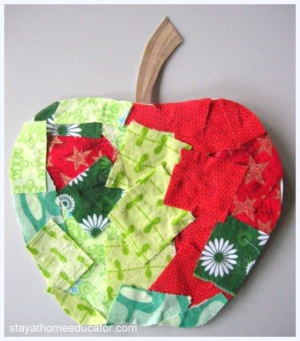 Apple Collages – Students made apple collages using scrapes of fabric in apple-like colors.  I glued yarn to the back of each apple to make a loop for hanging.