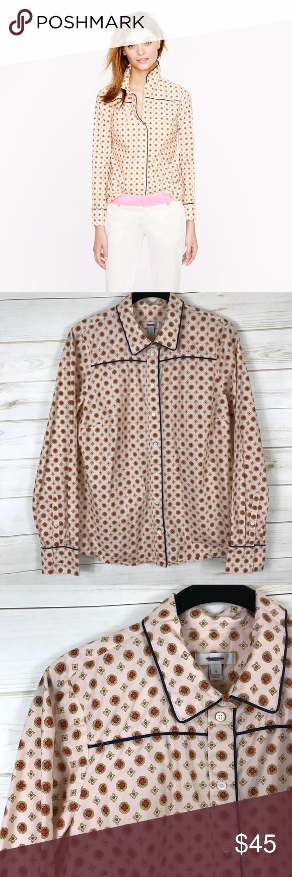 [J. Crew] Light Pink Piped Printed Button Down • NWOT • Excellent Condition • Long Sleeve • Pink Background • Blue Piping • Printed • Button Down • 8 Buttons Down Front • 3 Button Cuff • Collared • Boyfriend Pajama Inspired Look • Style Name: Piped Foulard • Label Blacked Out to Prevent Store Returns • Length: 14ins • Bust: 36ins • Sleeve Length: 24.5ins • 100% Cotton J. Crew Tops Button Down Shirts