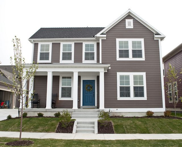 Blue door, white trim, smokey gray/brown siding. Love the blue... maybe add blue shutters?