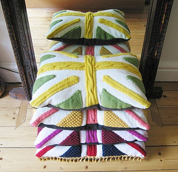 'Percy' Union Jack Cable Knit Cushion. Individually hand-knitted cushion in union jack pattern in 100% Italian merino wool with gold trim.  Includes feather cushion pad.  Dimensions 42cm x 62cm Various colours. £125