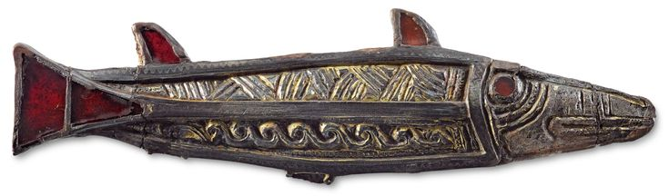 Brooch: Garnet, copper alloy, gilt. Westbere, Kent. (c) Canterbury City Council, Museums and Galleries.
