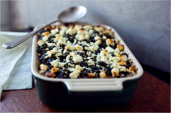 """Baked Large Limas With Spinach and Feta. New York Times. """"This Greek-inspired dish makes a hearty one-dish meal, and it's a great way to include nutrient-dense spinach in your diet. If you use baby spinach, the preparation will go quickly as the beans simmer."""" Vegetarian"""