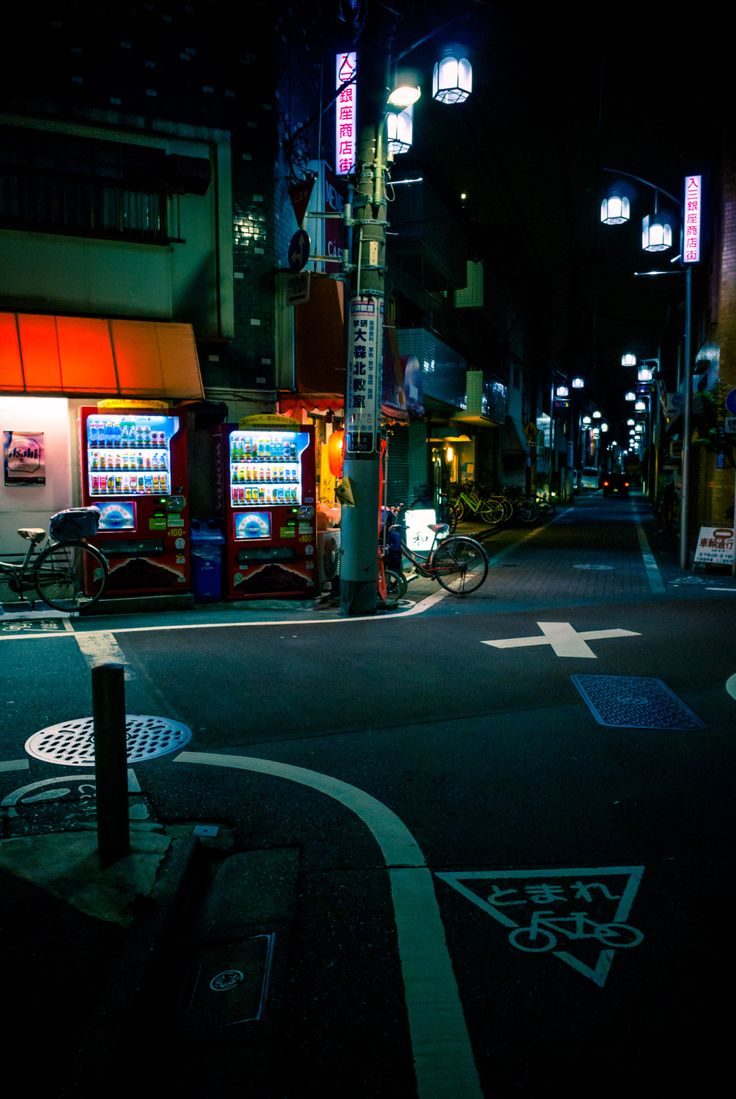 Tokyo street by night. Japan is the no. 1 nation in the use of vending machines, from which most are in operation 24/7. Most machines go into an energy saving mode during nighttime, but they're always open for business.