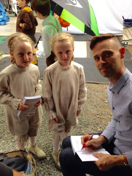 Unmasked 10-year-old twins Thomas and Joseph Odwell, who play the masked telepathic twins on the set with Ransom Riggs author of Miss Peregrine's Home for Peculiar Children.