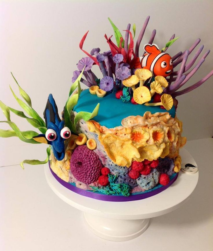Finding Nemo Cake by The Mischief Maker. Both of the figures and coral are hand sculpted and are made of sugar dough.