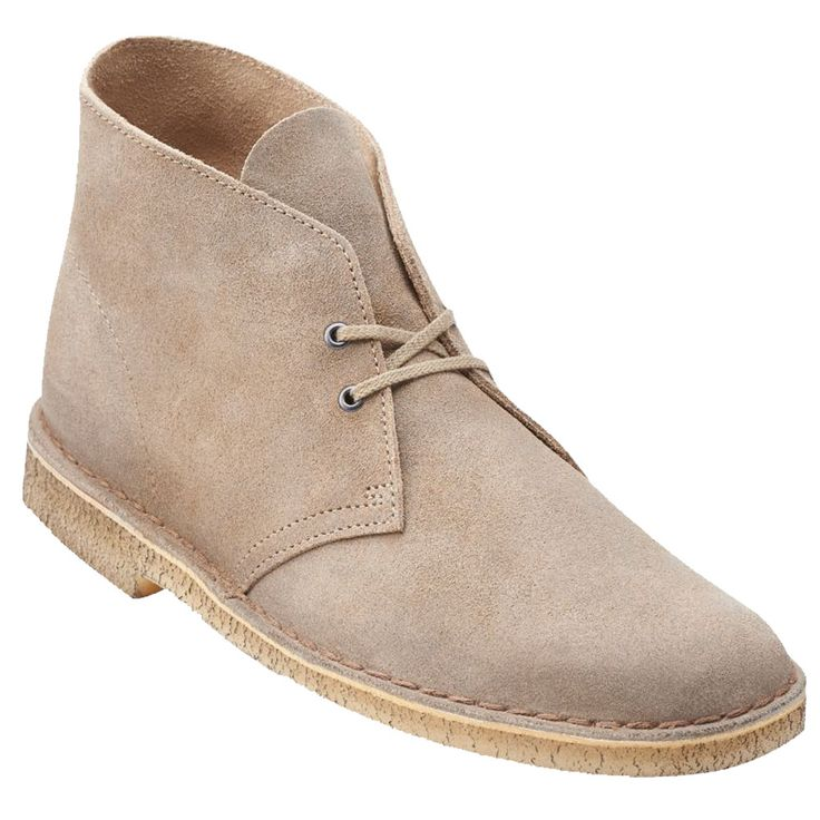 An international cult classic, the iconic men's Desert Boot by Clarks Originals® was inspired by crepe-soled boots worn by British officers in World War II. Crafted from natural materials including ta
