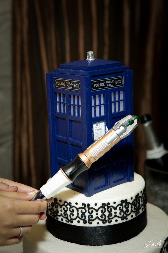 Tardis wedding cake with sonic screwdriver cake cutter